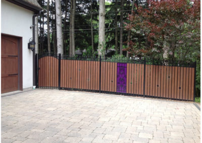 Paver Driveway With Decorative Fencing
